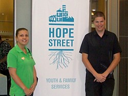 Two event attendees in front of Hope Street banner. 28 Nov 2013: Hope Street Annual General Meeting - click image to open event album