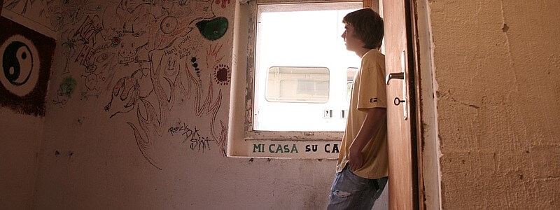 Young man in derelict room